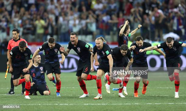 Croatia players celebrate following their sides victory in a penalty shoot out during the 2018 FIFA World Cup Russia Round of 16 match between...