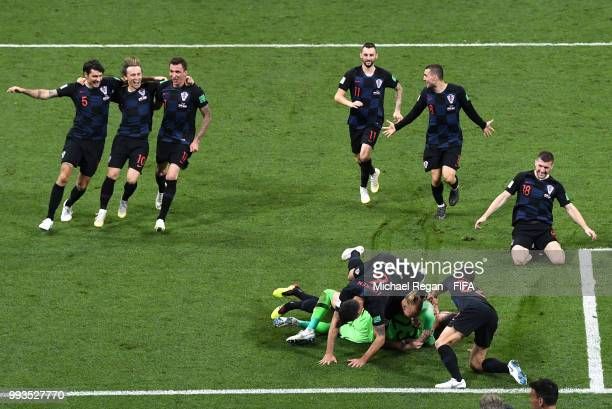 Croatia players celebrate following their sides victory in the 2018 FIFA World Cup Russia Quarter Final match between Russia and Croatia at Fisht...