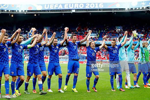 Croatia players celebrate their 10 win in the UEFA EURO 2016 Group D match between Turkey and Croatia at Parc des Princes on June 12 2016 in Paris...