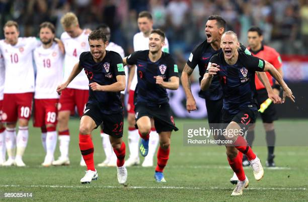 Croatia players celebrate their victory following the penalty shoot out during the 2018 FIFA World Cup Russia Round of 16 match between Croatia and...