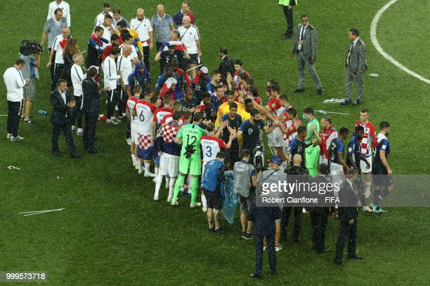 Croatia players congratulate the France players and give them a guard of honour as they go to receive the World Cup trophy during the 2018 FIFA World...
