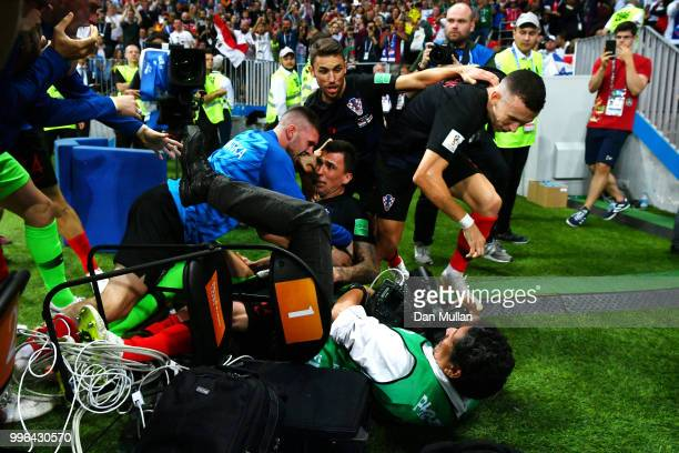 Croatia players knock over a photographer as they celebrate after Mario Mandzukic of Croatia scores their team's second goal during the 2018 FIFA...