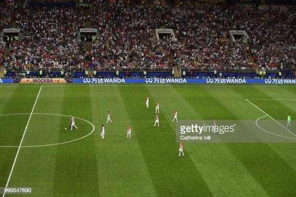 Croatia players walk dejected back to half way line to kick off after conceding a goal during the 2018 FIFA World Cup Final between France and...