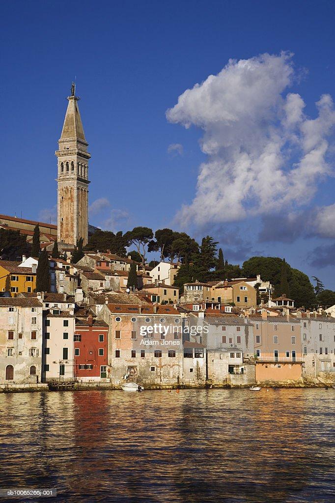 Croatia, Rovinj, Cityscape and St. Euphemia Cathedral reflecting in sea water : Foto stock