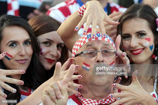 TOPSHOT Croatia supporters cheer before the round of sixteen football match Croatia against Portugal of the Euro 2016 football tournament on June 25...