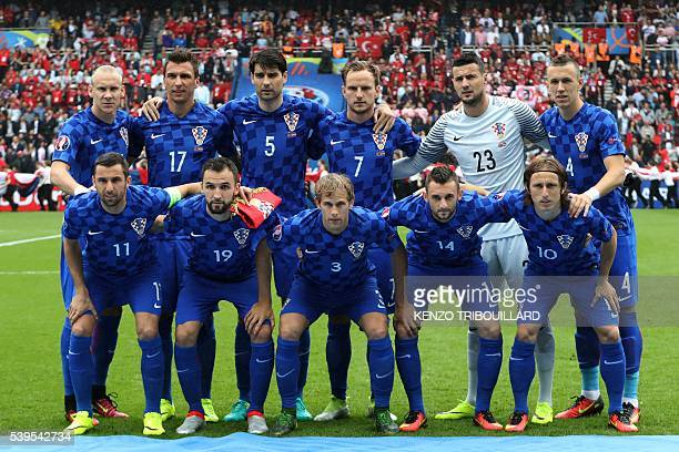 Croatia team members pose for a group photograph from bottom left Croatia's defender Darijo Srna midfielder Milan Badelj defender Ivan Strinic...