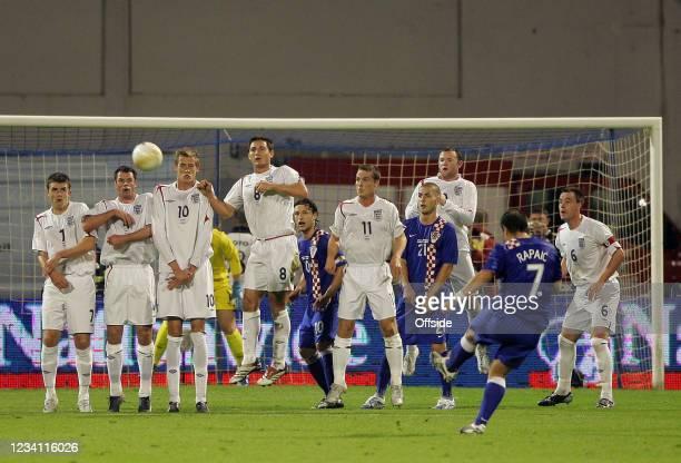 Croatia v England, England players jump to defend a Croatian free-kick at the Maksimir Stadium, Croatia.