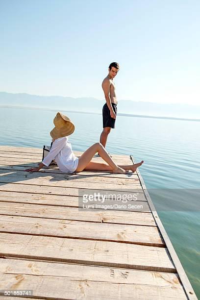 Croatia, Young couple in swimwear by the sea