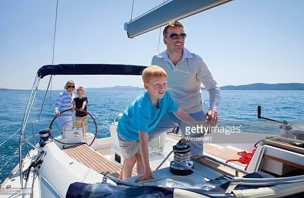 croatia, zadar, family on sailboat - bang boat stock pictures, royalty-free photos & images