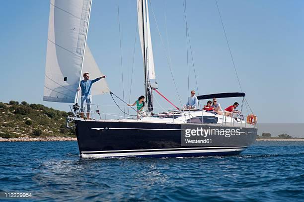 Croatia, Zadar, Friends relaxing on sailboat