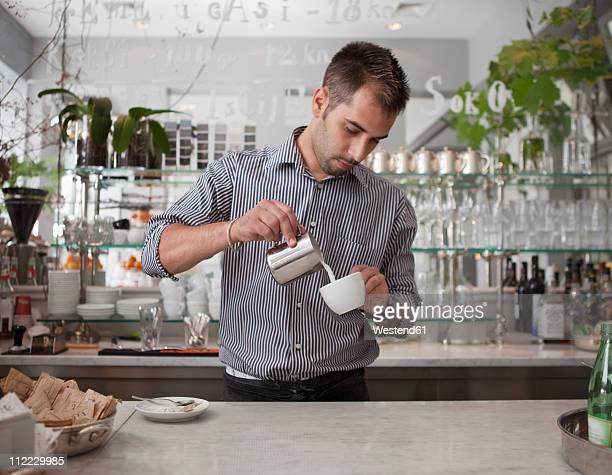 croatia, zagreb, barkeeper making coffee in cafe - zagreb stock-fotos und bilder