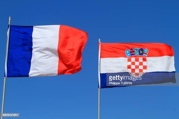 Croatian and french flags in blue sky.