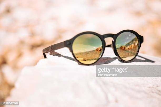 croatian beach mirroring in sunglasses on towel - sunglasses stock pictures, royalty-free photos & images
