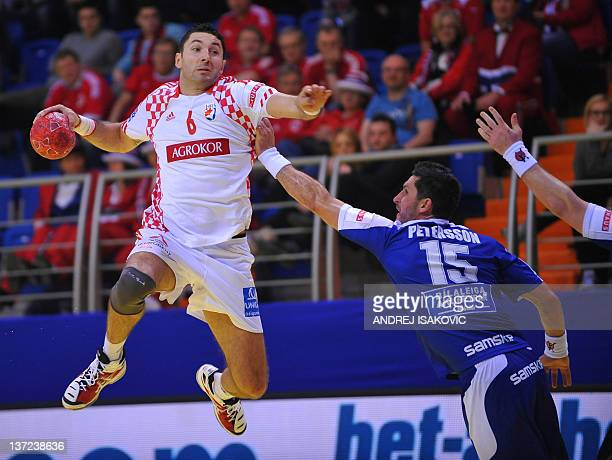 Croatian Blazenko Lackovic vies with Icelandic Alexander Petersson during the 10th 2012 EHF European Men's Handball Championship match on January 16...