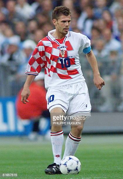 Croatian captain Zvonimir Boban looks to pass the ball to a teammate, 08 July at the Stade de France in Saint-Denis, north of Paris, during the 1998...