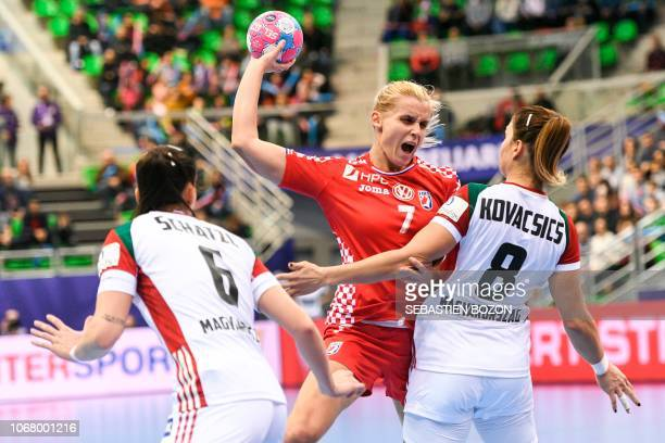 Croatian center back Dora Krsnik vies with Hungarian center back Aniko Kovacsics during the preliminary tour of the group C of the Euro 2018...