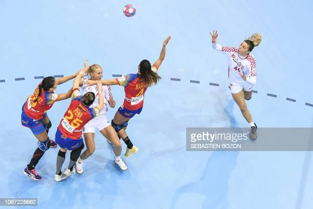 Croatian center back Dora Krsnik vies with Spanish right back Almudena Rodriguez Spanish center back Nerea Pena Abaurrea and Spanish right wing...