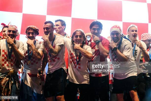 Croatian coach Zlatko Dalic and Luka Modric along with Croatian national football team players attend a welcoming ceremony at the Bana Jelacica...