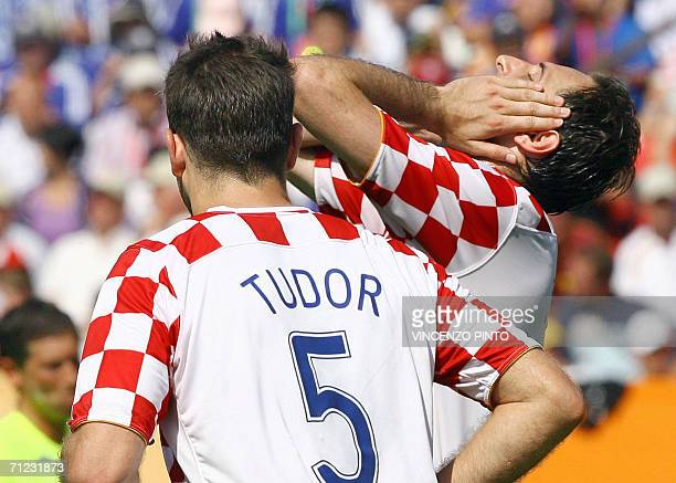 Croatian defender Igor Tudor reacts with teammate during the World Cup 2006 group F football match Japan vs Croatia 18 June 2006 at Nuremberg stadium...