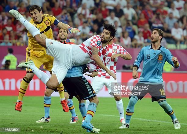 Croatian defender Vedran Corluka vies with Spanish goalkeeper Iker Casillas during the Euro 2012 football championships match Croatia vs Spain on...