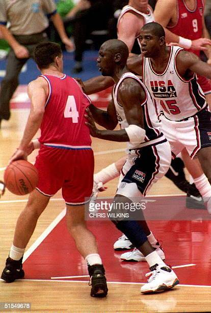 Croatian Drazen Petrovic is guarded by US Michael Jordan and Magic Johnson 08 Aug during the final game of the basketball competition at the '92...