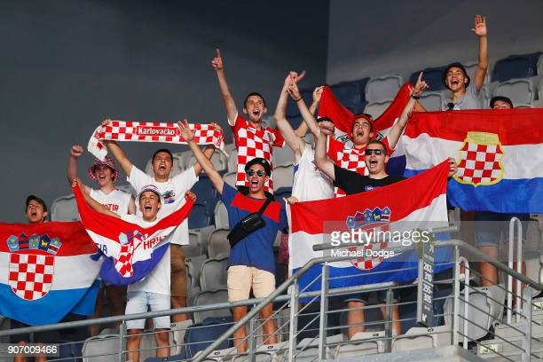 Croatian fans celebrate as Marin Cilic of Croatia wins in his third round match against Ryan Harrison of the USA on day five of the 2018 Australian...