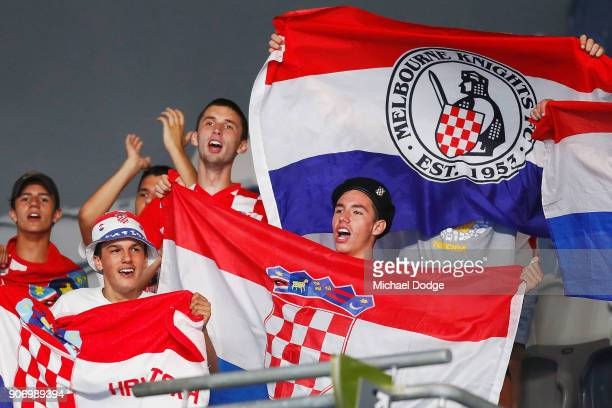 Croatian fans celebrate as Marin Cilic of Croatia wins the second set on day five of the 2018 Australian Open at Melbourne Park on January 19 2018 in...