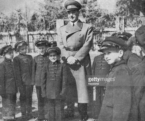 Croatian fascist leader Ante Pavelic visits a school in Croatia and poses with the children circa 1943 Pavelic was appointed leader of the...