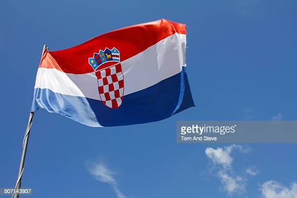 Croatian flag flying against a blue sky