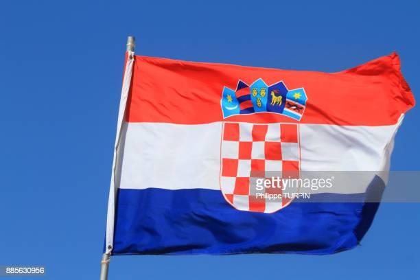Croatian flag in blue sky.