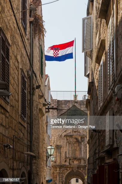 croatian flag in korcula town - terence waeland stock pictures, royalty-free photos & images