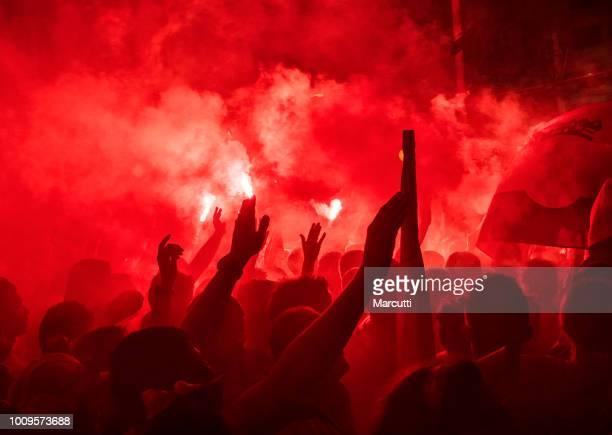 Croatian football fans burn a bengal fire