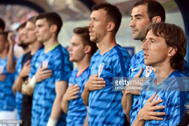 Croatian football team captain Luka Modric listens to the national anthem with his teammates prior to the 2019 international friendly football match...