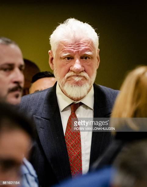 Croatian former general Slobodan Praljak arrives at the International Criminal Tribunal for the former Yugoslavia prior to the judgement in his...