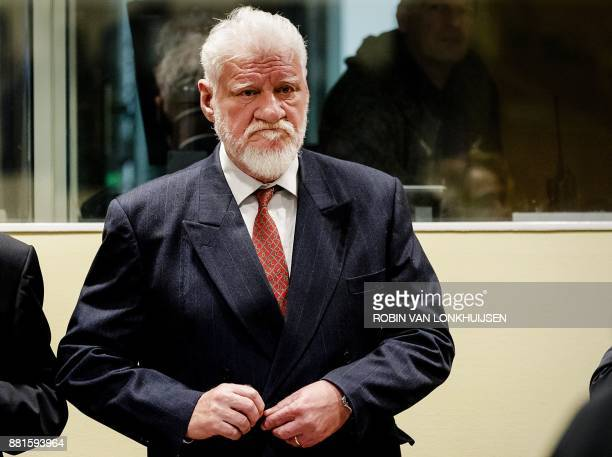 Croatian former general Slobodan Praljak stands prior to the start of his appeal judgement at the International Criminal Tribunal for the former...