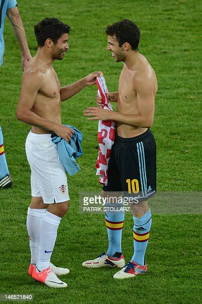 Croatian forward Eduardo exchanges his jersey with Spanish forward Cesc Fabregas at the end of the Euro 2012 football championships match Croatia vs...