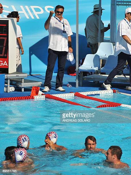 Croatian head coach Ratko Rudic jubilates with his players after beating the U.S team at the end of the Men' water-polo Bronze-Medal match on August...