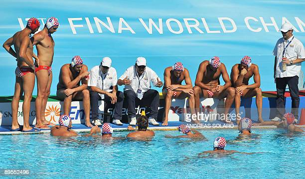 Croatian head coach Ratko Rudic speaks with his players during the Men' water-polo Bronze-Medal match on August 1, 2009 at the FINA World Swimming...