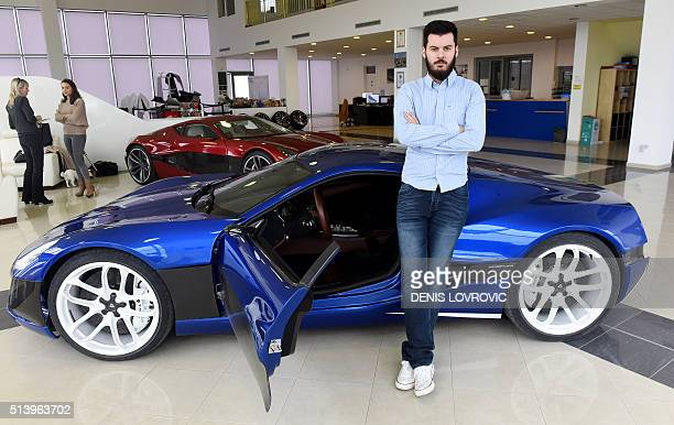 Croatian inventor Mate Rimac poses next to his Concept One supercar model at his factory and showroom in Sveta Nedelja on the outskirts of Zagreb on...