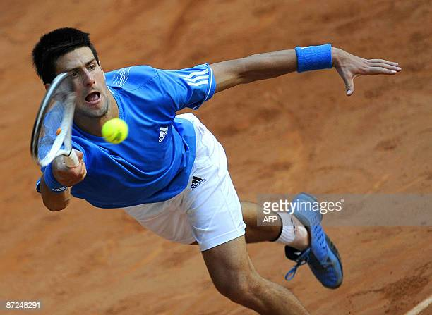 Croatian Ivan Ljubicic returns the ball against Serbian Novak Djokovic during their match at the ATP Madrid Open claycourt tournament on May 15 2009...