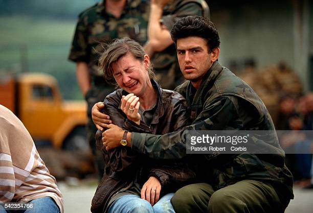 A Croatian man tries to comfort a woman who is crying as they and fellow Croats flee their village in Bosnia The Croatian refugees fled the area...