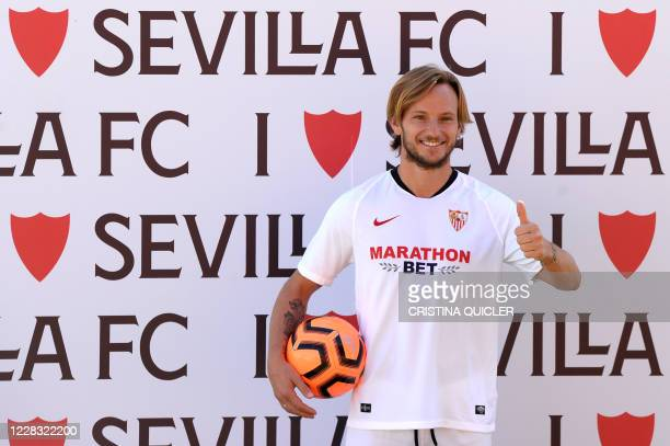 Croatian midfielder Ivan Rakitic poses during his official presentation as new player of Sevilla FC at the Ciudad Deportiva Jose Ramon Cisneros...