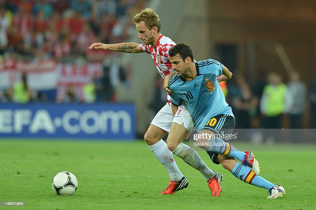 Croatian midfielder Ivan Rakitic (L) vies with Spanish midfielder Cesc Fabregas during the Euro 2012 football championships match Croatia vs Spain on June 18, 2012 at the Gdansk Arena.