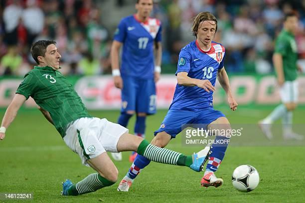 Croatian midfielder Luka Modric vies with Irish midfielder Stephen Ward during the Euro 2012 football championships match Ireland vs Croatia on June...
