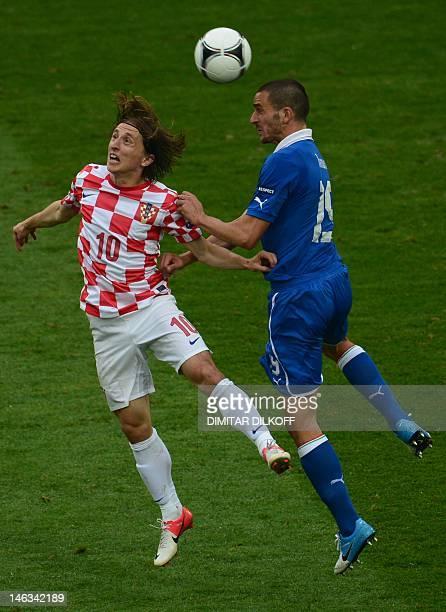 Croatian midfielder Luka Modric vies with Italian defender Leonardo Bonucci during the Euro 2012 championships football match Italy vs Croatia on...