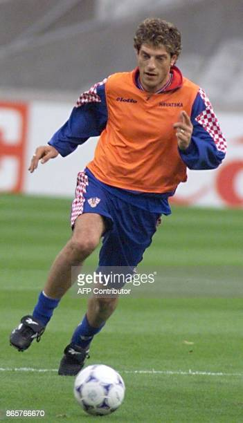 Croatian midfielder Nicola Jurcevic dribbles during a training of the Croatian national soccer team at Gerland stadium in Lyon central France 03 July...
