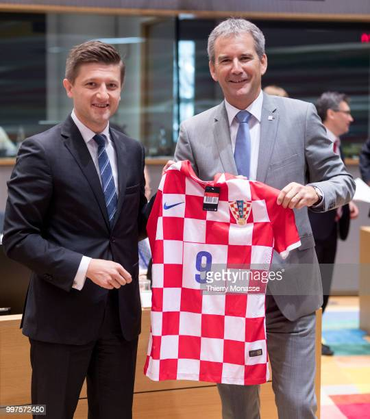 BRUSSELS BELGIUM JULY 13 Croatian Minister of Finance Zdravko Maric is giving a Croatian Football team jersey to the Austrian Finance Minister...