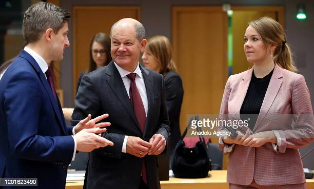 Croatian Minister of Finance Zdravko Maric talks with German Federal Minister of Finance Olaf Scholz and Finnish Finance Minister Katri Briitta Ilona...