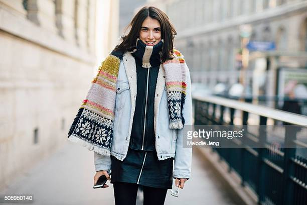 Croatian model Ana Buljevic wears multipattern scarf over a light blue denim/shearling jacket and carries a black leather backpack with gold metal...