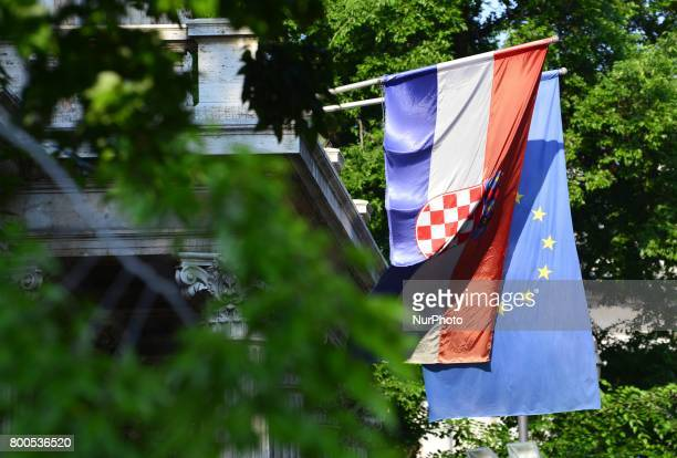 A Croatian national flag and Europe flag are seen in Zagreb Croatia on 24 June 2017